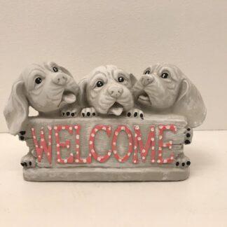 Velkommen skilt med hundehvalpe